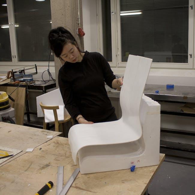 7. Jennifer Wong holding final uncut foam shell of Kari 3 chair
