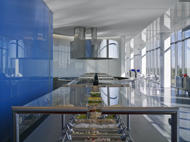 There are three food preparation areas within the restaurant. This is the center food service area; the exhaust fan becomes a mirrored sculpture.