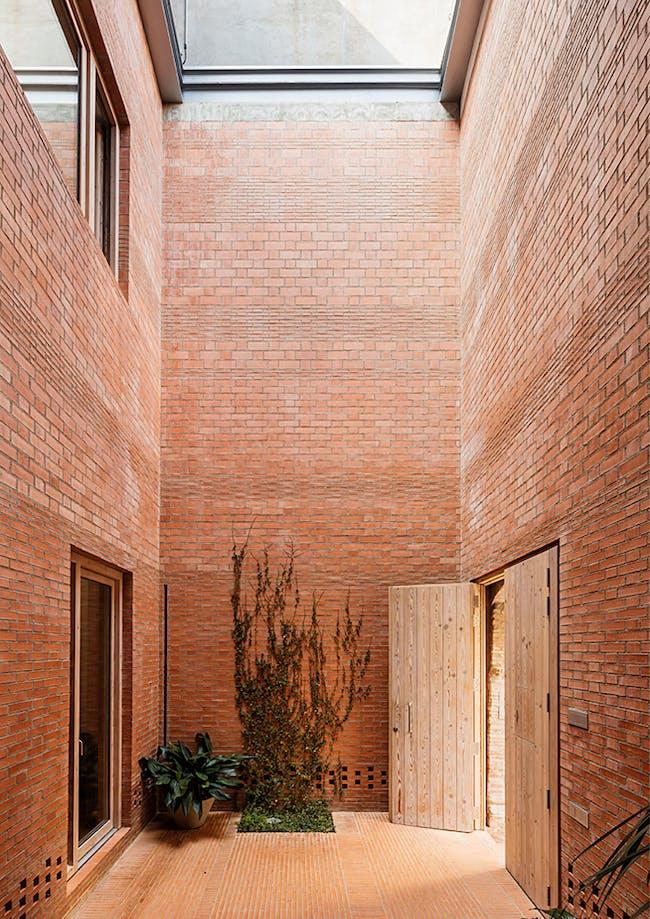 House 1014, Granollers, ES. Image via: HARQUITECTES