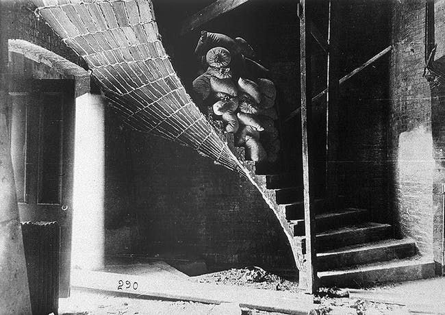 A load test on a landing of a Guastavino tile stair at the First Church of Christ Scientist demonstrates the spatial and structural complexities, as well as the strength, of the company's tile vaulting. Courtesy of Avery Architectural and Fine Arts Library, Columbia University