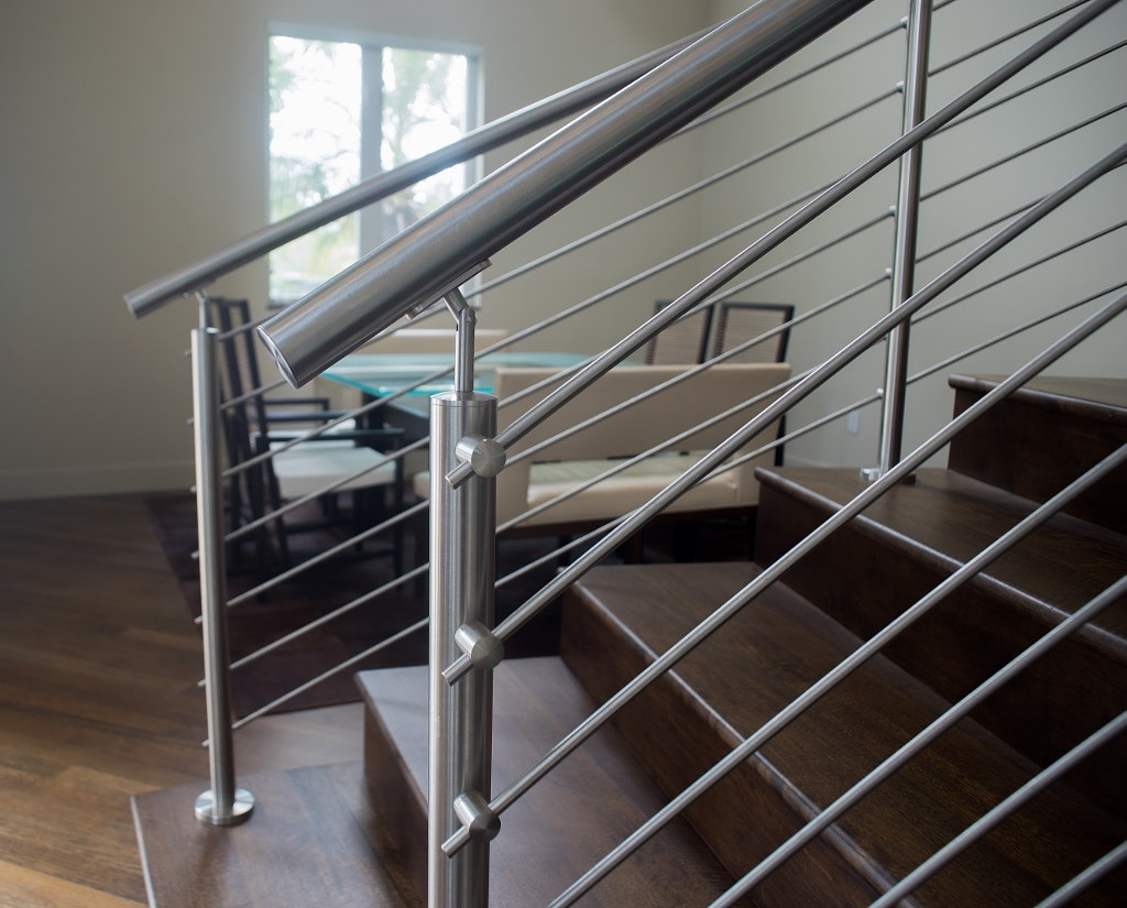 Stainless Steel Handrails Were Top Mounted To The Railings.