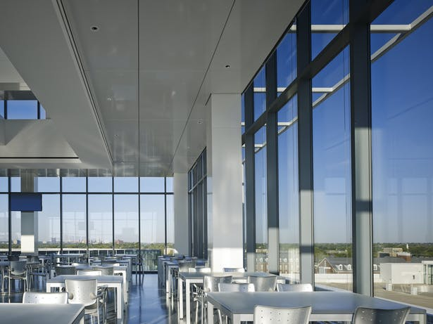 The north dining space is the sushi bar. The stainless steel bar, terrazzo floors and white glass cladding create a crisp, fresh atmosphere. The exposed framework on the right is the LED light line visible only from afar not from inside the restaurant.