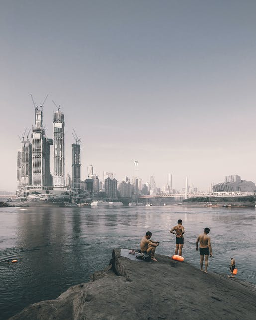 Sense of Place — Swimmers on the riverside opposite the construction of Raffles City Chongqing, China by Safdie Architects. Photographer: Zhu Wenqiao