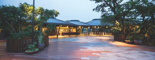 A series of two-storey huts at the entrance plaza provides human scale. Functioning as a village, the entrance plaza is designed for resting and socialising