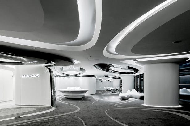 Showroom Interior : Approaching the showroom, its entrance obliquely carved into the corridor next to the elevator lobby with a curved glazing entrance leading the visitors' attentions towards the interior features within. The showroom interior manifests the energy of skipping stones and dynamic of splashing water. Hence, the directional shapes and propagating curves organize various functional zones into a system of spatial conditions and topological variations, giving the visitors unique...