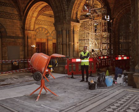 Paul Gallagher in the Hintze Hall, currently undergoing refurbishment. All photos by author.