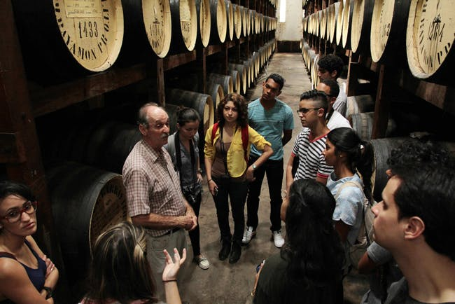 Participants on a tour of a rum facility. Image via 'Play With Your Food'.