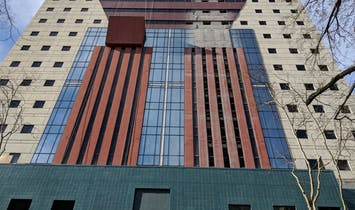 The iconic Portland Building's postmodern, multicolored facade is dismantled