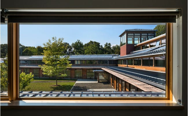 Roof-mounted solar-thermal panels, which heat water at Choate Rosemary Hall. It is one of more than a dozen tactics that the Kohler Environmental Center uses to reduce energy use to net zero. Photographer: Peter Aaron/Robert A. M. Stern Architects