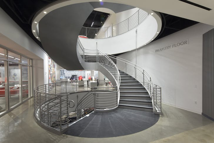The interior stairway joining the three levels of the museum (image via The Petersen Museum)