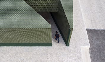 m2.senos creates a public restroom coated in green ceramic tile for a cemetery in Portugal