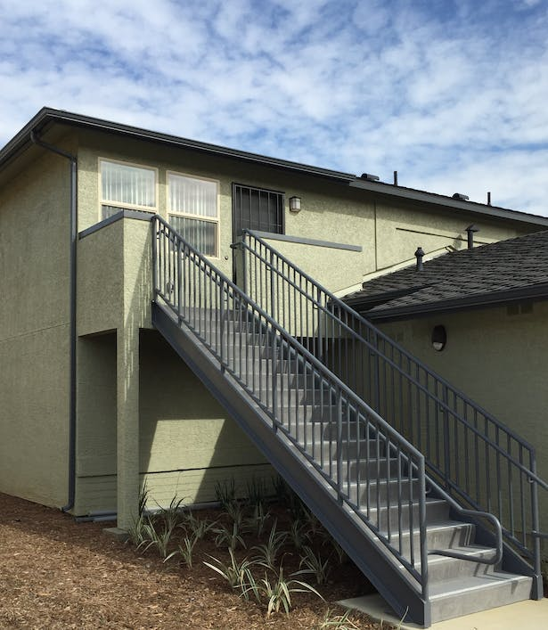 Side by side townhouses converted to 'flats' / Remodel incorporates new stairway to second floor unit, fenestration, etc.