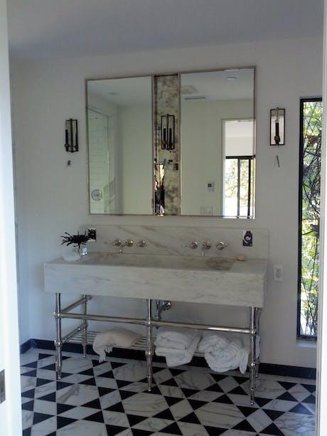 Custom built polished nickel medicine cabinet and custom CNC marble sink