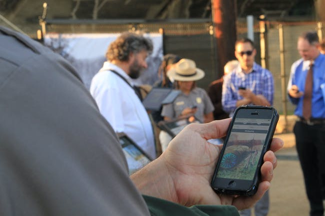 A park ranger previews the LASHP Trails app at the Wellspring launch event. Photo credit: IMLab-UCLA.