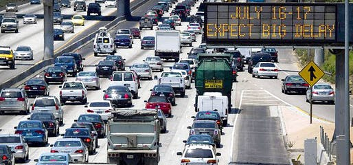 A sign warns motorists of a two-day closure of Interstate 405 on July 16 and 17 because of construction. (Jonathan Alcorn / Bloomberg / July 12, 2011)