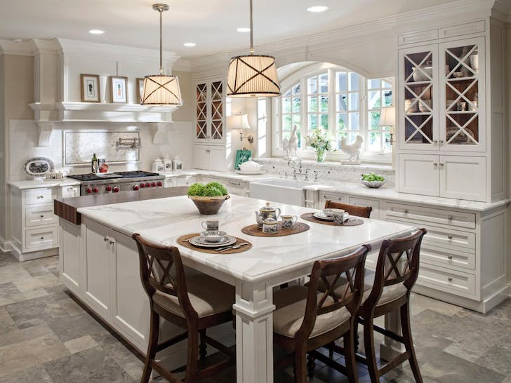 A kitchen featuring an island with seating for four. Photo by Tina Muller for Drury Design.