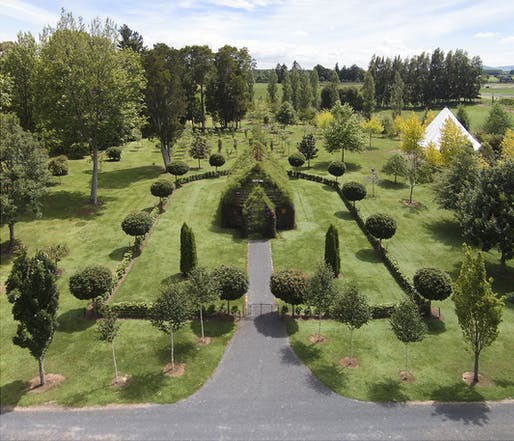 The quaint little Tree Church blends effortlessly into its garden surroundings. Photo: Barry Cox/Tree Church, via Slate