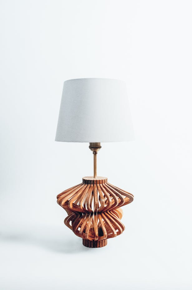 Overall shot - The Final lamp is milled from Black Walnut at 1/4' thick and is hand assembled. After the form is completed it is then finished using a clear stain called 'the good stuff'.