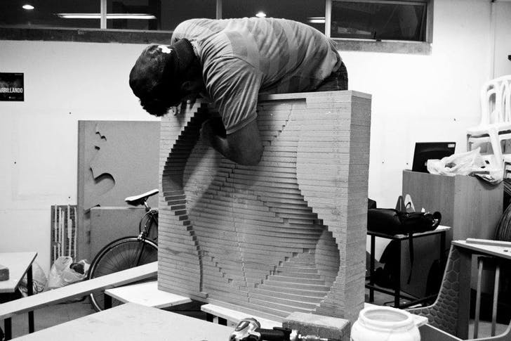 Assembling the top layer of the mold to create the seat and channels for the canicas (marbles).