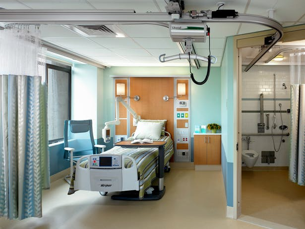 Rehabilitation Acute Care Patient Room with overhead Liko lifting system.