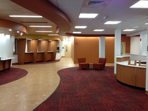 Lobby space with check-in kiosks, recpetion and lounge areas
