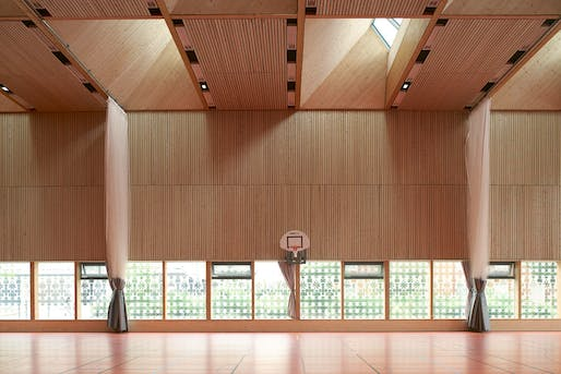 MERIT: Multi-functional Sports Hall Alice Milliat, Lyon, France, Dietrich | Untertrifaller Architekten and Tekhnê Architectes. Courtesy of the 2017 Wood Design & Building Awards.