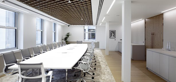 Formal meeting rooms feature interesting detailing, such as timber latticework ceilings