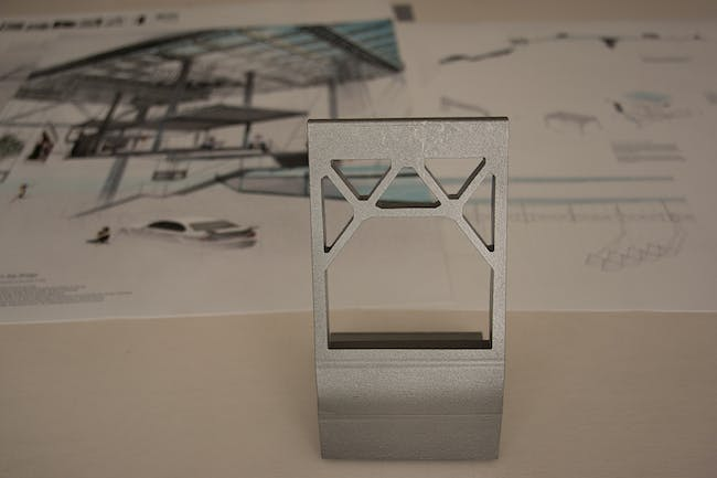 Bay Bridge House trophy with winning proposal in the background. Image courtesy of Bay Bridge House.