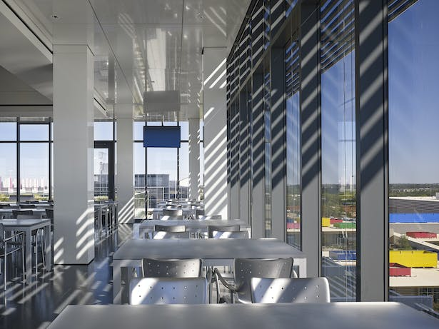 South dining room cantilever lets you float above the ground. The lattice provides sun shading and a 300º view of the horizon connects you to the city.