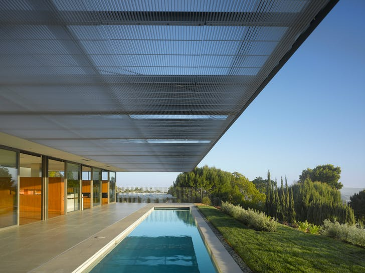 A large trellace provides shade and privacy for the homeowners. Image courtesy of SPF:architects