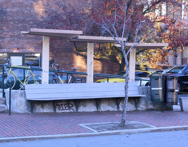 The awnings are designed to allow rainwater to cascade off each of the three awnings and away from the bench.