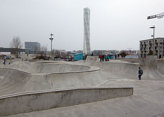 Turning Torso in the background of a community skate park