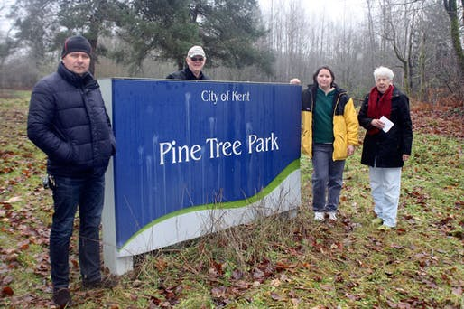 Kent residents Andrey Pristatskiy, Ric Herrick, Traci Dysart and Kristy Herrick oppose a city decision to sell the 10-acre Pine Tree Park to a developer who plans to build 64 homes. Image Credit: Steve Hunter, Kent Reporter