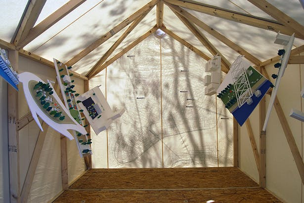 The interior of one of our prototype tents, including several models.