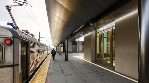blackened stainless steel canopy over the railroad platform