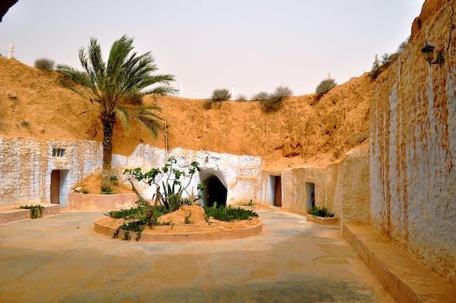 The interior courtyard of a troglodyte structure in Matmata. Credit: Wikipedia