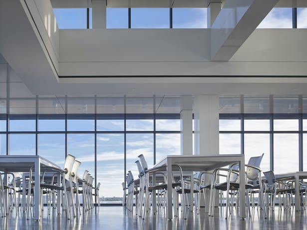 The south dining area is raised providing an amazing view to downtown. 180º views and clerestory glass reinforce the idea of being in the clouds.