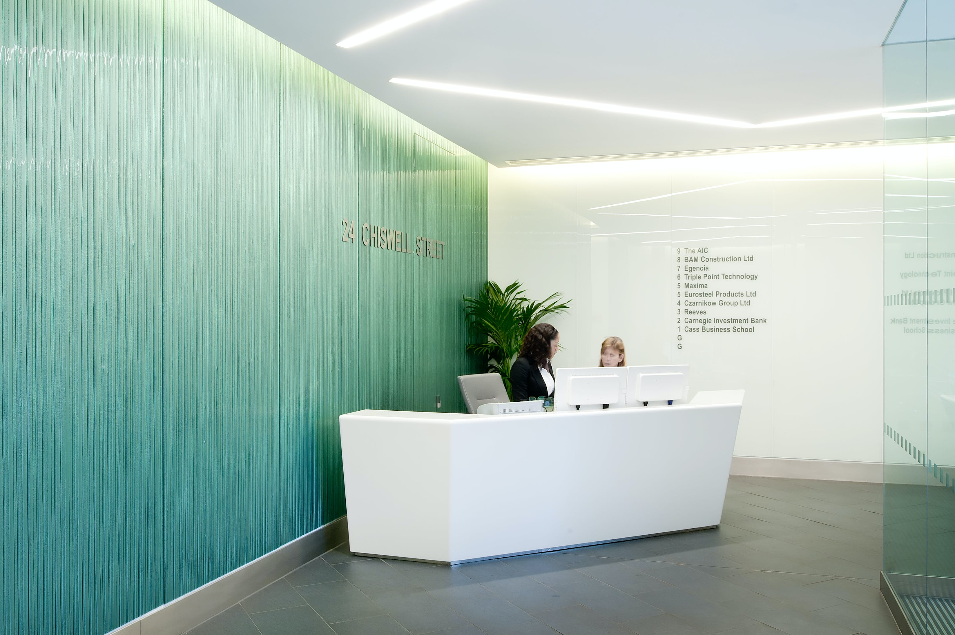Glass cladding for office lobby and lift area mike for Back painted glass design