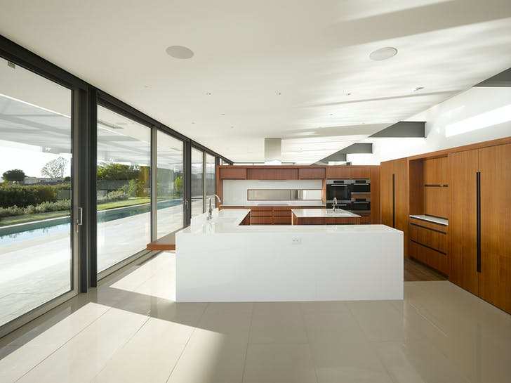 The kitchen looks out onto an amazing view on the LA basin. Image courtesy of SPF:architects