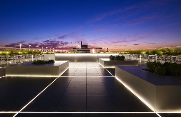 Sunrise on the Skyline roof deck. The square pattern of the LED lights connects to the construction grid of the entire building.