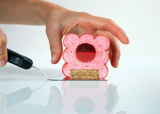 Raspberry cake made to look like red bubbles encased in a cube by Dinara Kasko. Image: Dinara Kasko.