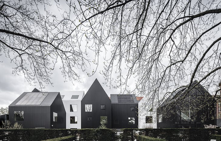 The kindergarten's multi-structured sihloette mirrors the dwellings that line the streets of Copenhagen's Frederiksberg neighborhood.