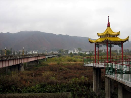 Bridge near the border town of Tumen City linking China with North Korea in the background. Photo: Prince Roy/Flickr