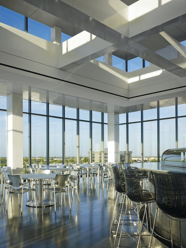 The north dining space is the sushi bar. The stainless steel bar, terrazzo floors and white glass cladding create a crisp, fresh atmosphere.