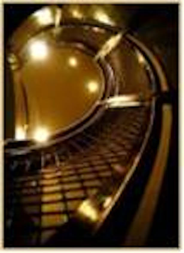 Interior picture of spiral stainless steel stair.