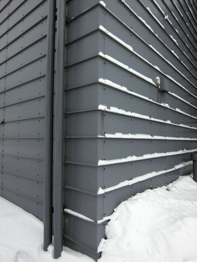 Horizontal standing seam wall cladding on Rovaniemi Airport by Heikkinen-Komonen