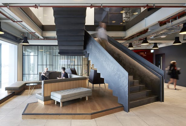 The stairs also act as partial enclosures for informal meeting areas