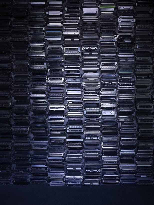 A wall of recycled toner cartridges references the waste associated with printing today. Recycling 1 cartridge saves 3.6 lbs. of solid waste. En masse they create a unique texture and emphasize that beauty can come from unexpected places.