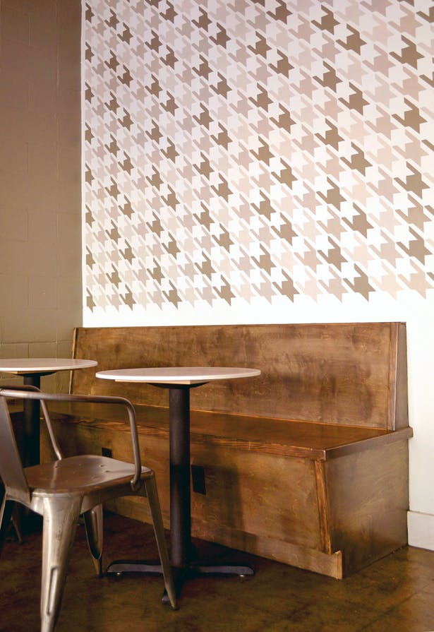 We designed a new built in bench and a houndstooth mural for the cafe