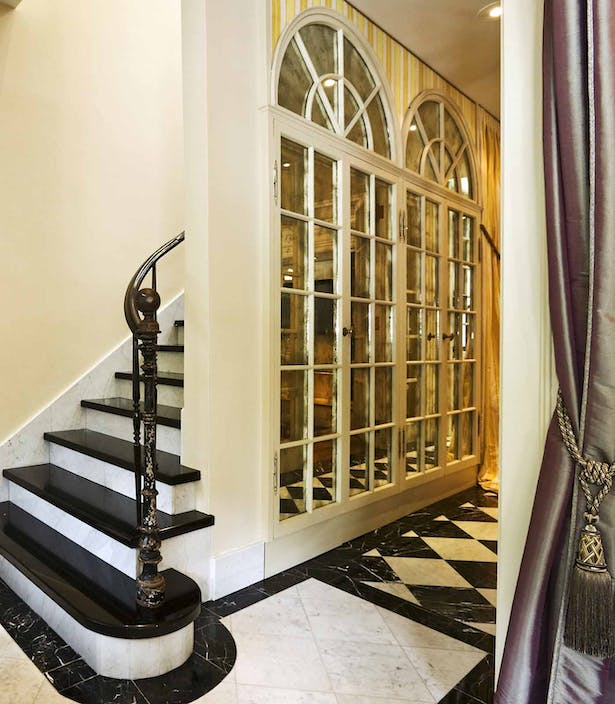 Foyer steps. The mrrored arched door were removed and relocated.